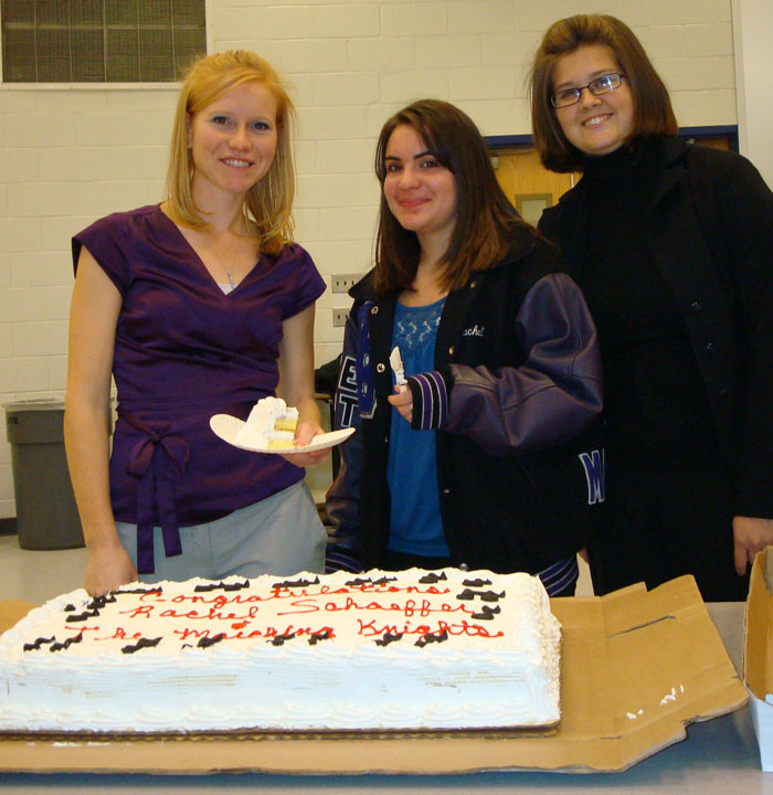 Rachel and band directors with cake