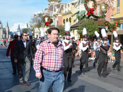 "LAKE BUENA VISTA, Fla. (Dec. 20, 2016) – Robert J. Sherman, son of American songwriter and Disney legend Robert B. Sherman, paraded down iconic Main Street U.S.A. at Magic Kingdom with the Harnett Central High School ""Marching Trojans"" from Angier, N.C. on Monday, entertaining thousands of Walt Disney World Resort guests."