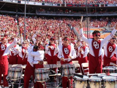 The Pride of Oklahoma drumline celebrating a touchdown.