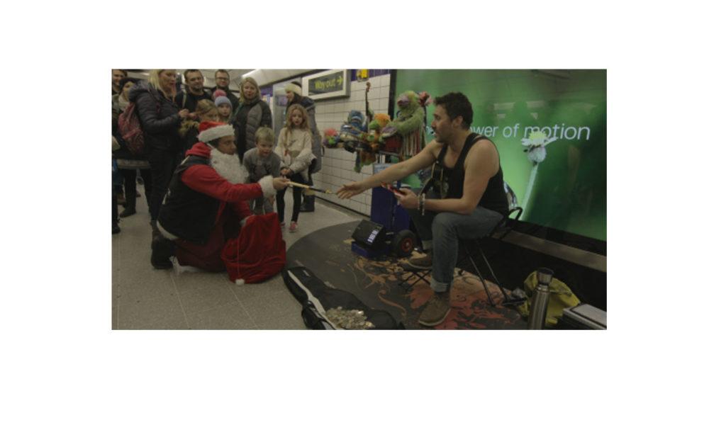 """Saint"" Nick D'Addario Spreads Joy to the Street Musicians Across London."