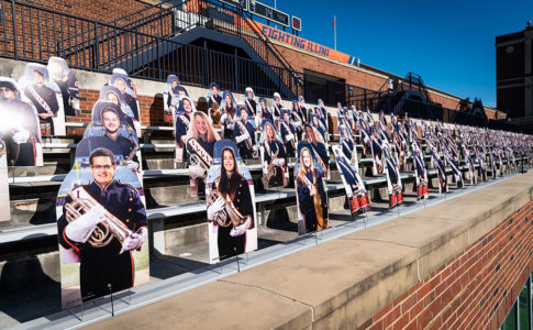 A photo of cardboard cutouts of members of the spirit of Marching Illini.